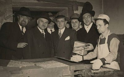Irving Streit, center, son of Streit's Matzo founder Aron Streit, in an undated photo at New York's Lower East Side factory. (Courtesy of Menemsha Films/via JTA)