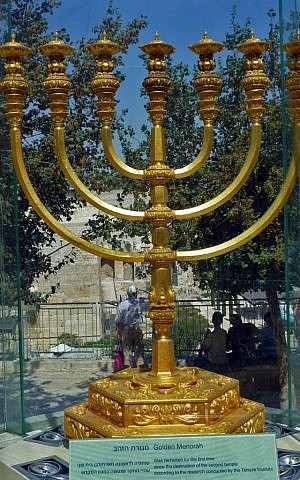 The solid gold menorah, ready for use in the Third Temple. It was constructed by the Temple Institute and is currently showcased in Menorah square overlooking the Western Wall and Temple Mount. (The Temple Institute)