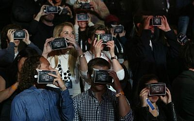 Watching an array of performers at the virtual reality Forbes 30 Under 30 concert in the Tower of David Museum in Jerusalem on April 6, 2016 (Courtesy Sasson Tiram)