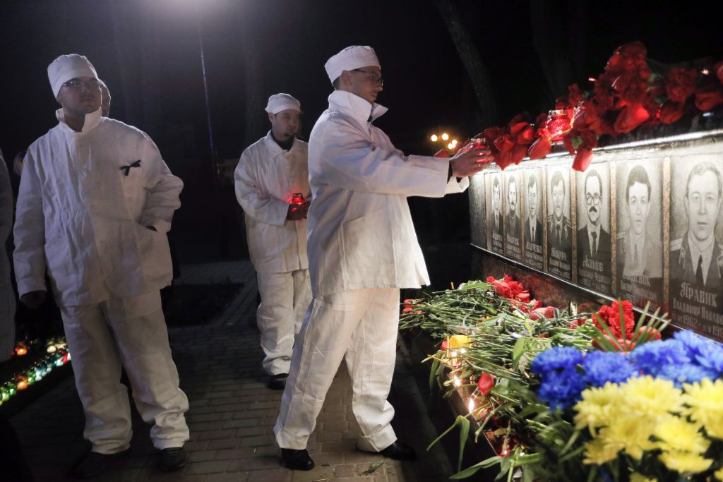 Chernobyl nuclear plant workers in uniform attend a ceremony to commemorate victims of the Chernobyl nuclear disaster at the memorial to Chernobyl workers and firefighters in the town of Slavutych, Ukraine, early Tuesday, April 26, 2016. Ukraine was marking the 30th anniversary of the Chernobyl nuclear disaster, when the 4th unit of the plant exploded early hours April 26, 1986. The city of Slavutych was built following the evacuation of Pripyat, the town of the Chernobyl plant workers, which was just 1.5 kilometers (about one mile) away from the plant. Some 50,000 Pripyat residents were evacuated after the disaster, taking only a few belongings. They never returned, and workers and their families now live in Slavutych. (AP Photo/Efrem Lukatsky)