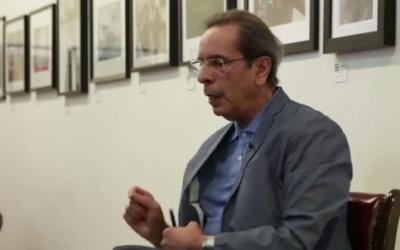 Palestinian writer Rabai al-Madhoun won a major award in April 2016 for his novel 'Destinies: Concerto of the Holocaust and Nakba' (Courtesy YouTube screen grab)