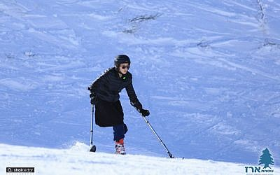 Israelis with disabilities participate in the Erez Foundation ski and snowboard program (Erez Foundation, a search & rescue and contribution to the community/Courtesy)