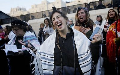 Members of the 'Women of the Wall' organization wear phylacteries as they pray at the Western Wall, Judaism's holiest site, in Jerusalem on January 02, 2014. (Miriam Alster/FLASH90)