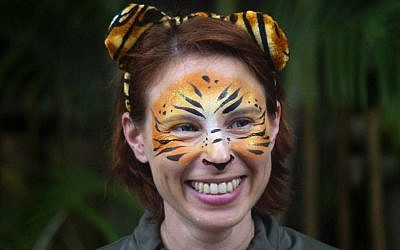 In this March 7, 2015 photo, Stacey Konwiser smiles during the dedication of the new tiger habitat at the Palm Beach Zoo in West Palm Beach, Fla. (Brianna Soukup/Palm Beach Post via AP)