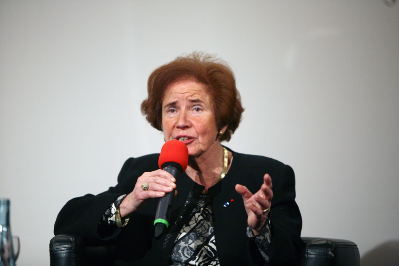 One of the more flamboyant Nazi hunters, Beate Klarsfeld addresses Germany's federal assembly in 2012 (Wikimedia Commons)