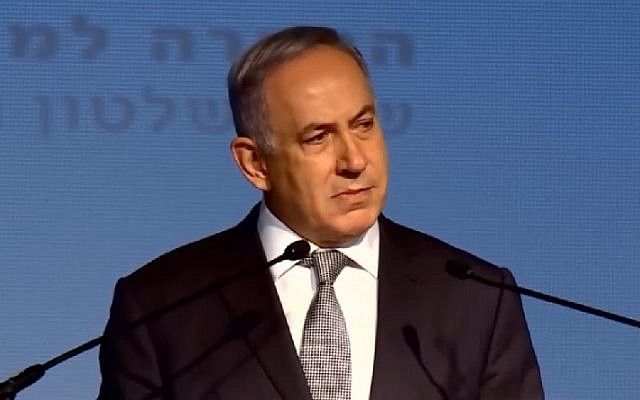 Prime Minister Benjamin Netanyahu speaks before an audience of the union of local authorities in Tel Aviv, April 14, 2016. (Screenshot/YouTube)