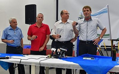 Eshkol regional council leader Tamir Idan, right, Defense Minister Moshe Ya'alon, center, and members of the local government raise a toast in honor of the approaching Passover holiday in southern Israel on April 18, 2016. (Ariel Hermoni/Defense Ministry)
