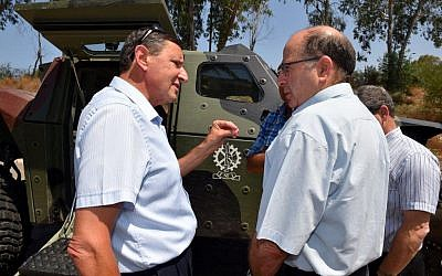 Defense Minister Moshe Ya'alon, left, and newly appointed Defense Ministry Director Udi Adam (Defense Ministry)