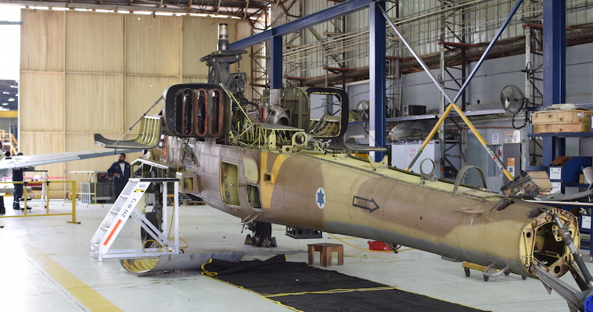 A helicopter damaged in a crash undergoing refurbishing. The light green areas are replacement parts printed with a 3D printer (IAF)