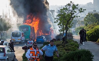 Firefighters and rescue personnel at the scene of a suicide bus bombing in Jerusalem, in which 20 people were wounded, on April 18, 2016, (Nati Shohat/Flash90)