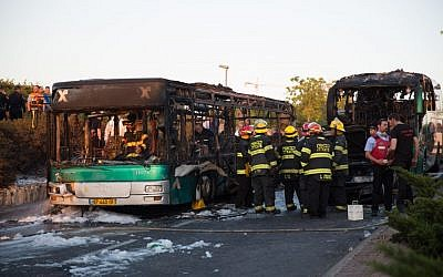 Firefighters and rescue personnel at the scene of a bus bombing in Jerusalem, on April 18, 2016. (Nati Shohat/Flash90)