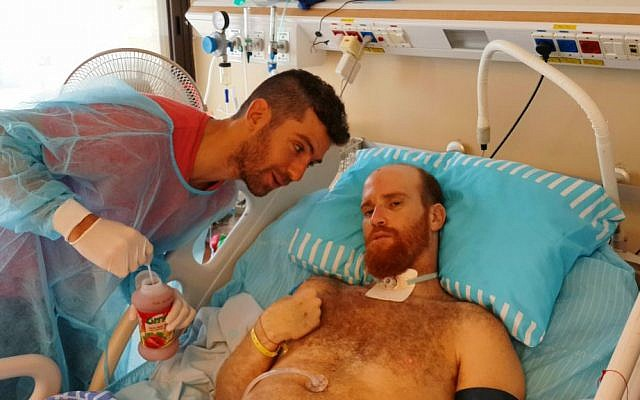 Sadan with friends in the hospital during his 2015 recovery. (Courtesy Roei Sadan)