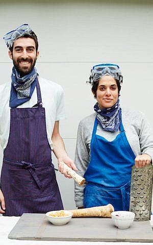 Jeffrey Yoskowitz and Liz Alpern prepare The Gefilteria's carrot-citrus horseradish relish for their book, 'The Gefilte Manifesto.' (Lauren Volo)