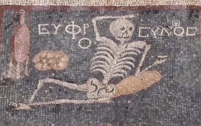 "A third century BCE mosaic featuring a skeleton and the words ""Be cheerful, enjoy life"" found in southern Turkey. (screen capture: Anadolu Agency video)"
