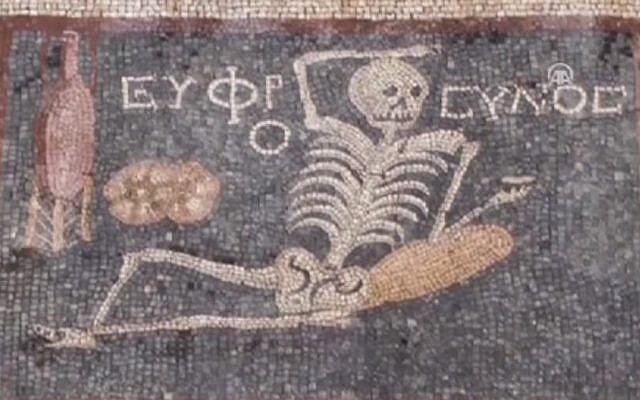 """A third century BCE mosaic featuring a skeleton and the words """"Be cheerful, enjoy life"""" found in southern Turkey. (screen capture: Anadolu Agency video)"""