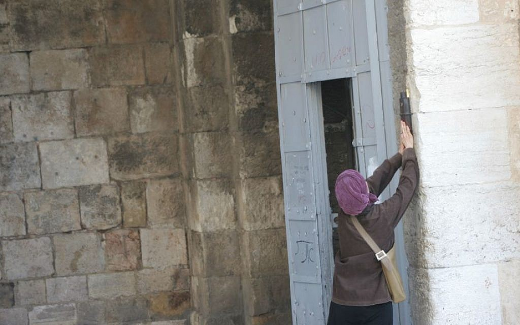 A large mezuzah is fastened to the right hand side of the gate. (Shmuel Bar-Am)