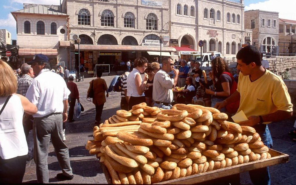 A bread seller caters to tourists inside Jaffa Gate. (Shmuel Bar-Am)