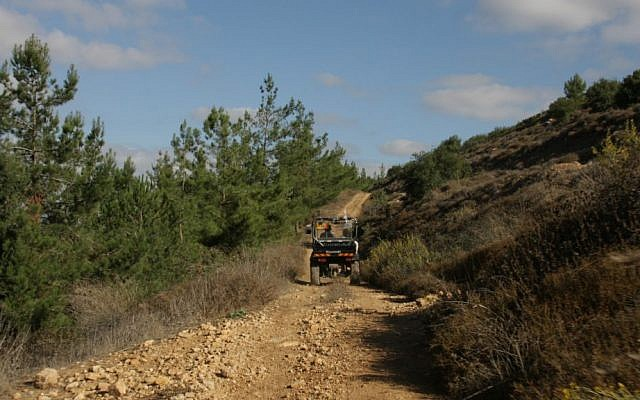 Taking an ATV ride near Kibbutz Kfar Etzion (Shmuel Bar-Am)