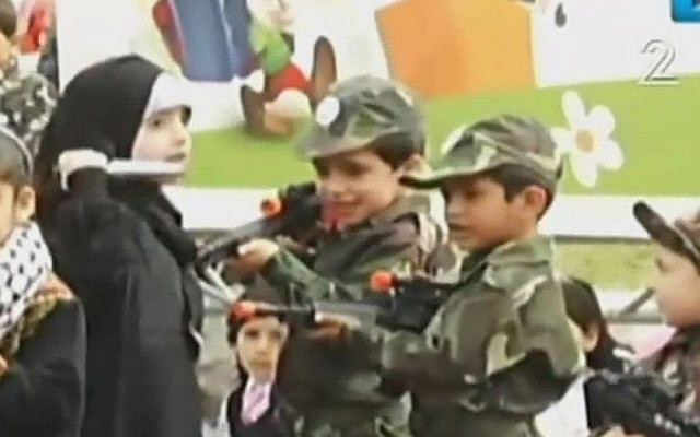 A young Palestinian girl attacks 'Israeli soldiers' with a knife in a play held in Gaza as part of the 'Palestine Festival for Children and Education,' April 2016 (Channel 2 news)