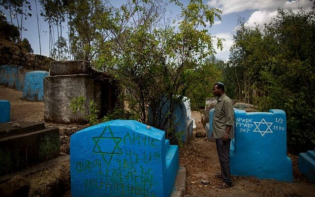 Gashaw Abinet, 29, a cantor at the HaTikvah synagogue in Gondar, visits Wolleka and its Jewish cemetery for the first time on April 24, 2016, although he has lived in Gondar for 17 years awaiting aliyah. (Miriam Alster / Flash9)