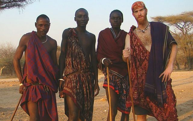 Sadan in Kenya with Masai tribe members during his round-the-world bike journey from 2007 to 2011. (Courtesy Roei Sadan)