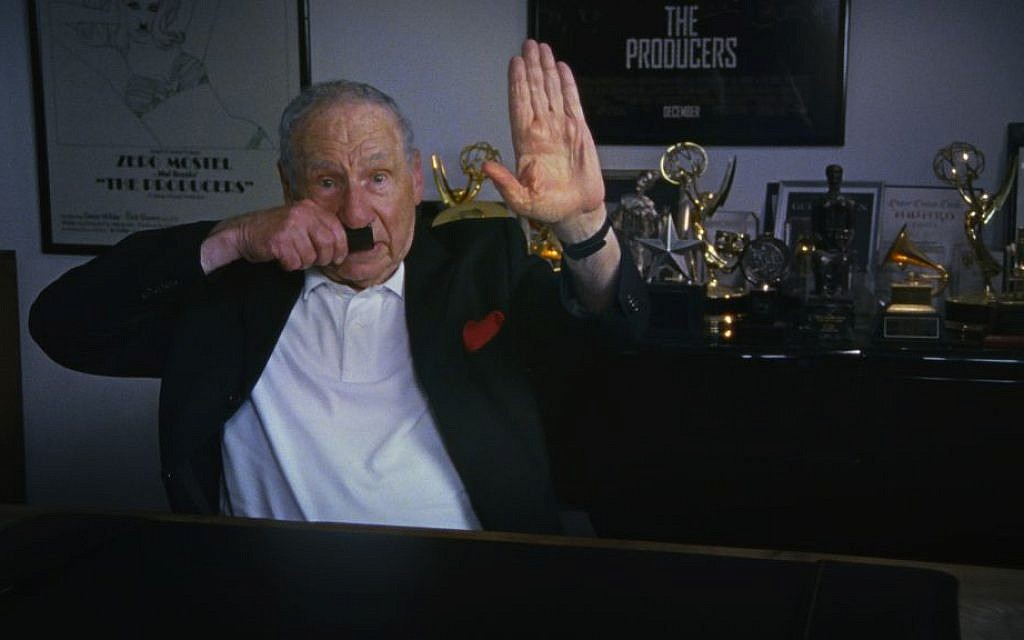 Mel Brooks doing a Hitler bit in an interview for 'The Last Laugh,' director Ferne Pearlstein's new documentary about Holocaust humor (Tangerine Entertainment/via JTA)