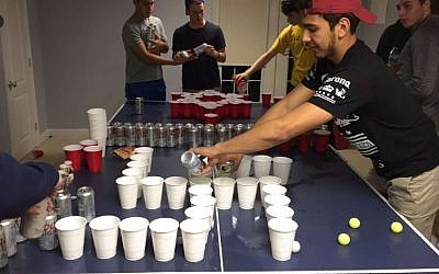 "A photo posted on social media showing students from a New Jersey school playing a ""Jews vs. Nazis"" drinking game (Facebook/Jamaica Ponder)"