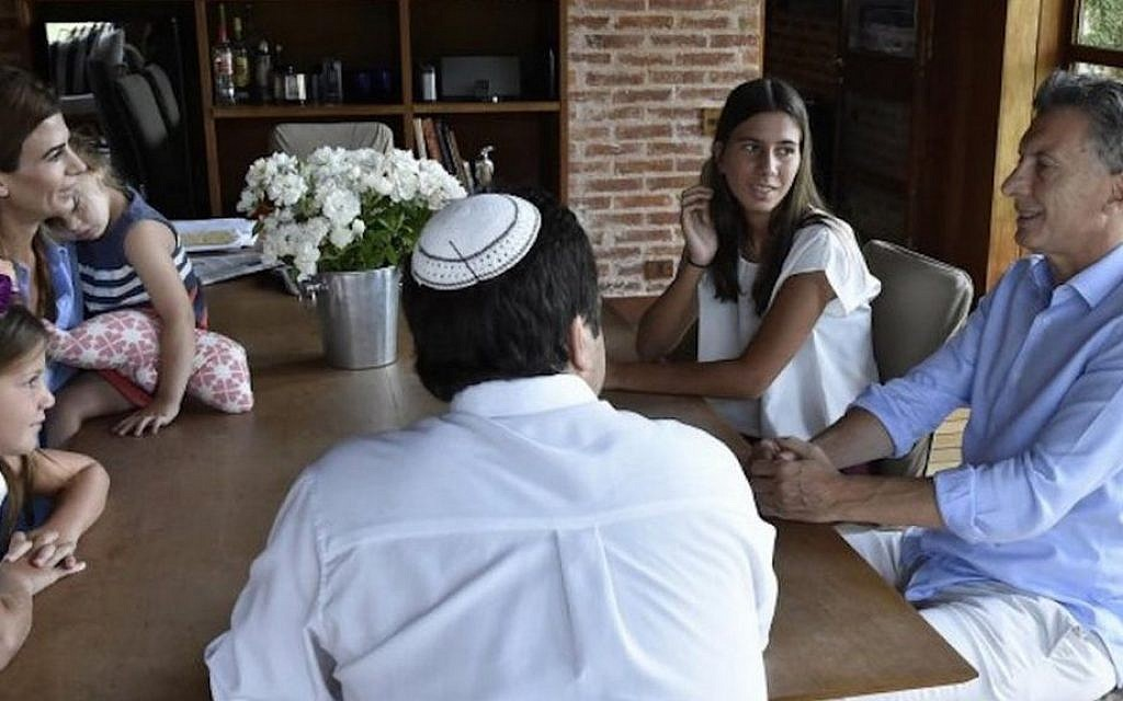 Newly elected Argentine President Mauricio Macri, right, invited the family of the late prosecutor Alberto Nisman to his home in January 2016. Clockwise to his left are Rabbi Marcelo Polakoff; Nisman's daughter Kala; Macri's wife, Juliana, and daughter Antonia, and Nisman's daughter Iara. (Office of the President of Argentina)