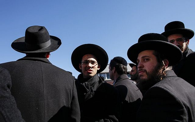 Orthodox Jewish men on March 22, 2015 in the Brooklyn borough of New York City. (Kena Betancur/Getty Images via JTA)