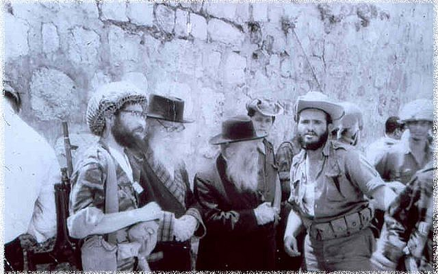 Gathering at the Western Wall to express thanks and gratitude. From left to right: Rabbi Yisrael Ariel (in combat helmet), the Nazarite, Rabbi David Cohen, and Rabbi Zvi Yehuda Kook. (The Temple Institute)