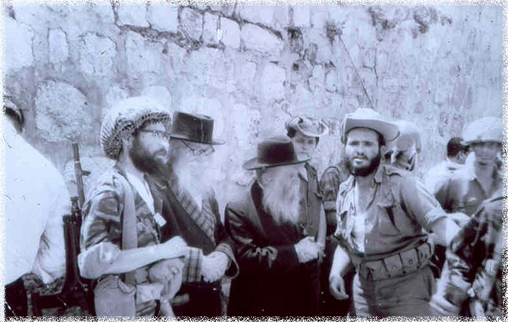 Gathering at the Western Wall to express thanks and gratitude. From left to right: Rabbi Yisrael Ariel (in combat helmet), the Nazarite - HaRav David Cohen, and HaRav Tzvi Yehuda Kook. (The Temple Institute)