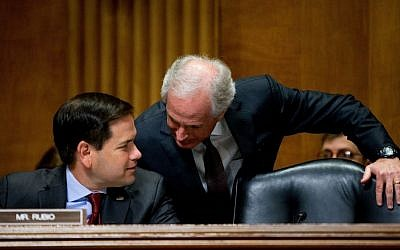 Senate Foreign Relations Committee Chairman Bob Corker, R-Tenn., right, speaks with Sen. Marco Rubio, R-Fla., on Capitol Hill in Washington, Tuesday, April 5, 2016, during the committee's hearing on recent Iranian actions and implementation of the nuclear deal. (AP/Andrew Harnik)