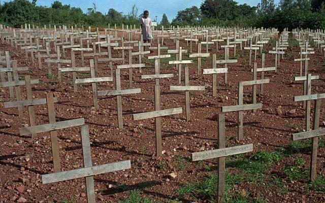 A young Rwandan girl walks through Nyaza cemetery outside Kigali, Rwanda, on Monday November 25, 1996, where thousands of victims of the 1994 genocide are buried (AP Photo/Ricardo Mazalan)