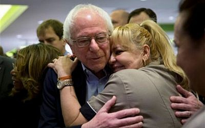 Democratic presidential candidate Sen. Bernie Sanders, I-Vt., right, is hugged by a hotel worker at MGM Grand hotel and casino Saturday, February 20, 2016, in Las Vegas. (AP Photo/Jae C. Hong)