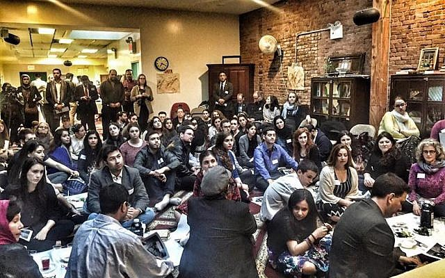 Jews and Muslims participating in a seder at the Islamic Society of Mid Manhattan, organized by the NYC Muslim-Jewish Solidarity Committee, April 14, 2016. (Facebook)
