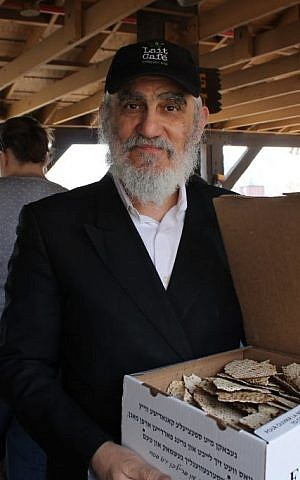 Pinchas Cohen, a restaurateur and father of nine from Brooklyn, brought his own box of handmade shmura matzah to the amusement park for Passover, April 25, 2016 (Uriel Heilman/via JTA)