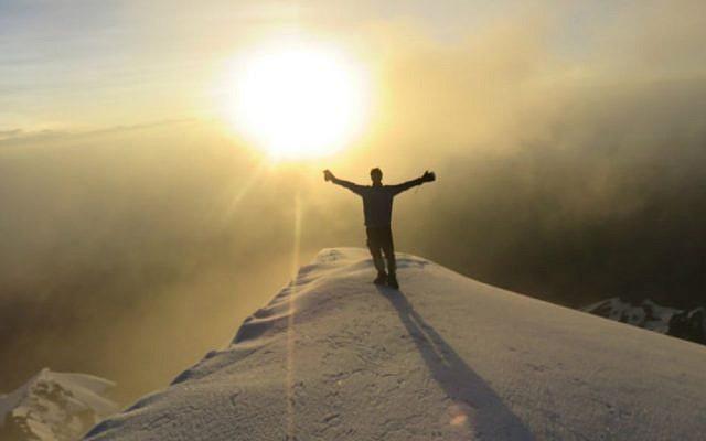 Roei Sadan on the summit of Stok Kangri, in northwest India, moments before his life changed. (Courtesy Roei Sadan)