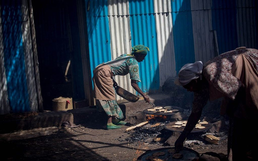 More than 20 Ethiopian Jewish women make matzah over fires in Gondar, Ethiopia on April 20, 2016. They receive a small salary at the end of the week. (Miriam Alster/Flash90)