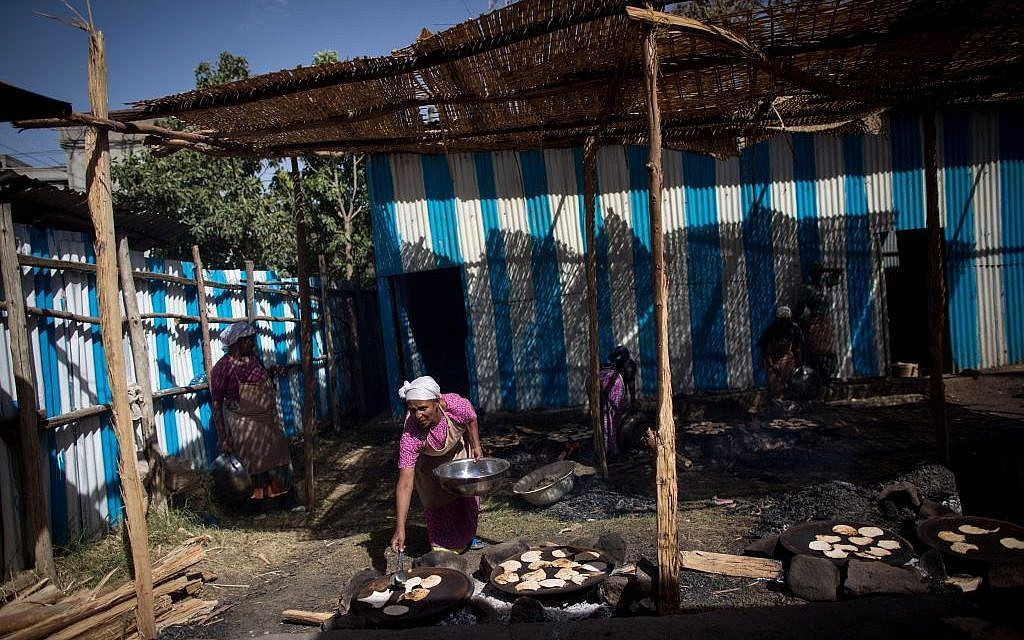 It takes more than 40 people a week to make 50,000 matzahs that the Jewish community of Gondar will eat during the week of Passover. (Miriam Alster/Flash90)