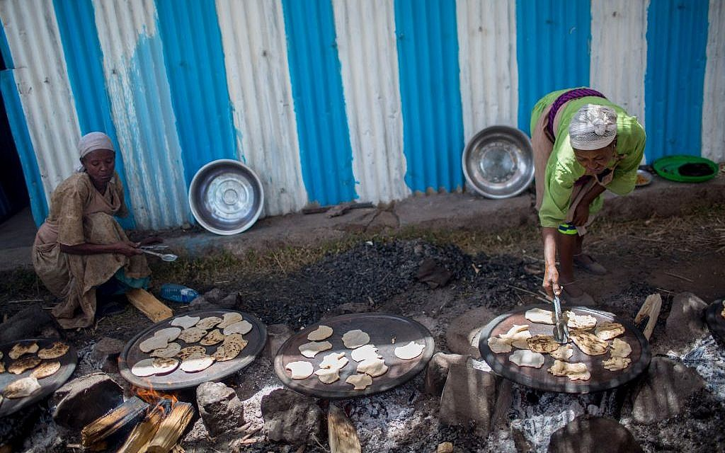 Members of the Gondar, Ethiopia, Jewish community prepare matzah before Passover on April 20, 2016. (Miriam Alster/Flash90)