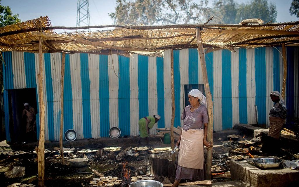 Members of Gondar's Jewish community prepare matzah before Passover on April 20, 2016. (Miriam Alster/Flash90)