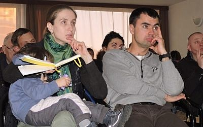 A Ukrainian couple seen at a pre-flight briefing for immigrants to Israel in Kiev, March 23, 2015. (JTA/Ben Sales)