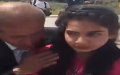 Dima al-Wawi being united with her father on April 24, 2016 (screen capture: YouTube/alAqsa TV)