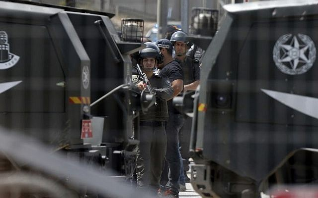 Israeli security forces stand guard at the Qalandiya checkpoint near Ramallah in the West Bank after a security guard shot dead two Palestinians at the crossing on April 27, 2016, after one of them threw a knife at border guards. (AFP/Abbas Momani)