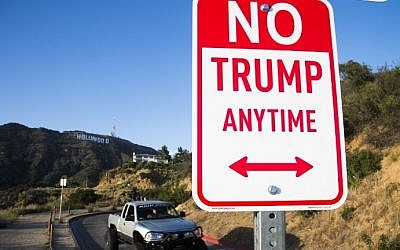 A sign reading 'No Trump Anytime' is seen near the iconic 'Hollywood' sign,  April 27, 2016 in the hills above Hollywood, California. (AFP PHOTO / ROBYN BECK)