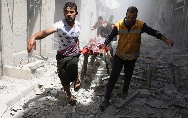 Syrian men carry a body on a stretcher amid the rubble of destroyed buildings following an air strike on the northern Syrian city of Aleppo, on April 29, 2016. (AFP Photo/Ameer Alhalbi)