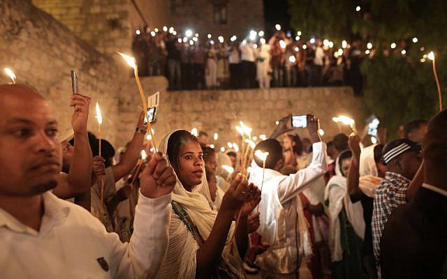 8bda010517b Ethiopian Christian pilgrims hold candles during an Ethiopian Orthodox  ceremony of the