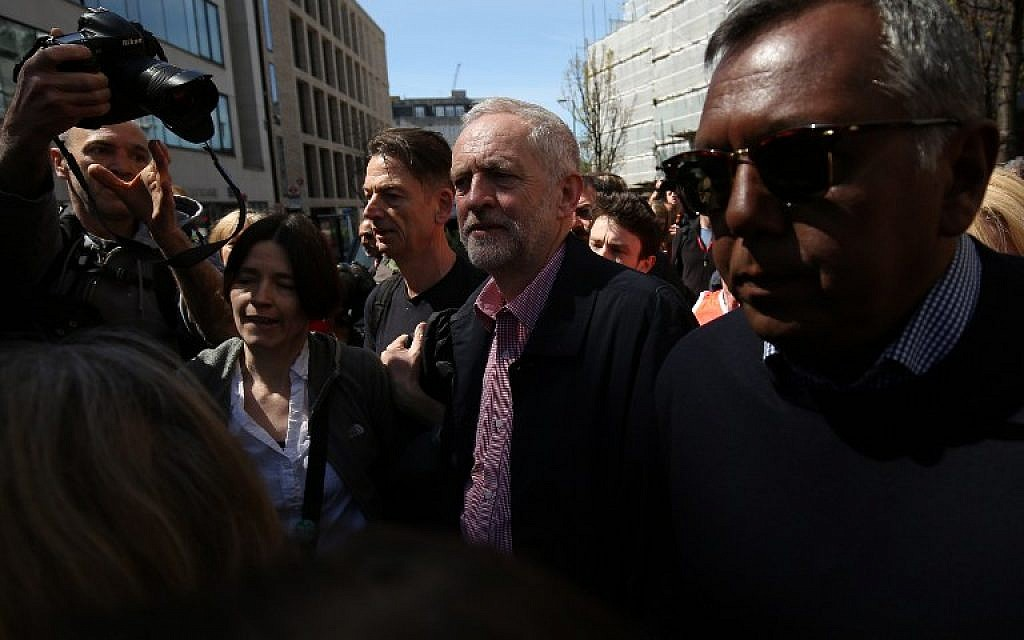 Britain's opposition Labour Party leader Jeremy Corbyn, center, leaves after giving a speech at a May Day rally in London on May 1, 2016. (AFP/JUSTIN TALLIS)