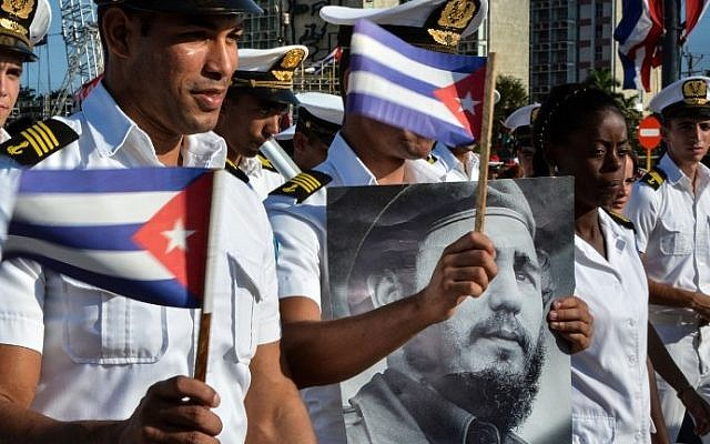 Members of the Navy display a picture of Cuban former president Fidel Castro during the May Day parade at Revolution Square in Havana, on May 1, 2016. (AFP PHOTO / JORGE BELTRAN)