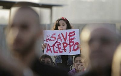 A Syrian girl holds a placard during a rally in solidarity with Aleppo, in the Lebanese northern port city of Tripoli, on May 1, 2016. (AFP/IBRAHIM CHALHOUB)